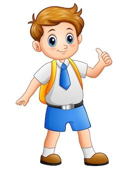 Leuke jongen in een schooluniform duimen opgevend