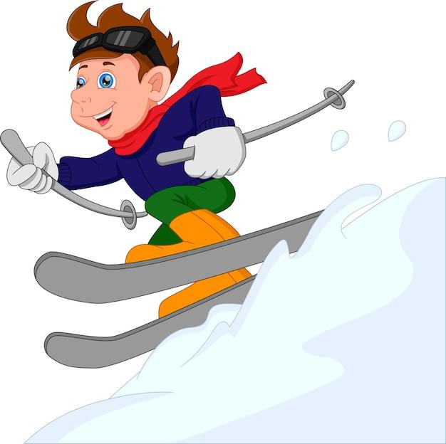 Leuke jongen is aan het skiën jongen glijdt op de skislee