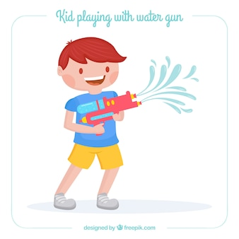 Leuke jongen spelen met waterpistool