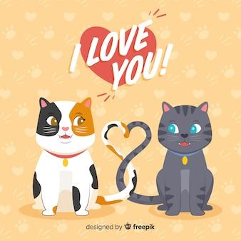 Leuke katjes die een hart met hun staarten maken