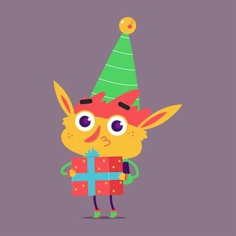 Leuke kerst elf met geschenkdoos stripfiguur geïsoleerd op de achtergrond