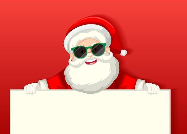 Leuke kerstman die het karakter van het zonnebrilbeeldverhaal draagt die lege banner op rode achtergrond houdt