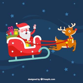 Leuke kerstman in zijn slee
