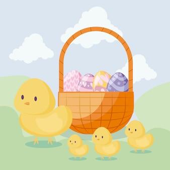 Leuke kippen met mand en eieren van pasen