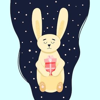 Leuke konijnenkaart met een cadeau in zijn poten