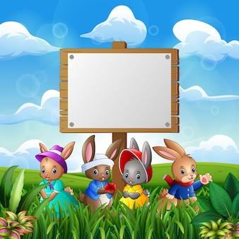 Leuke konijntjes met pasen-achtergrond en leeg teken