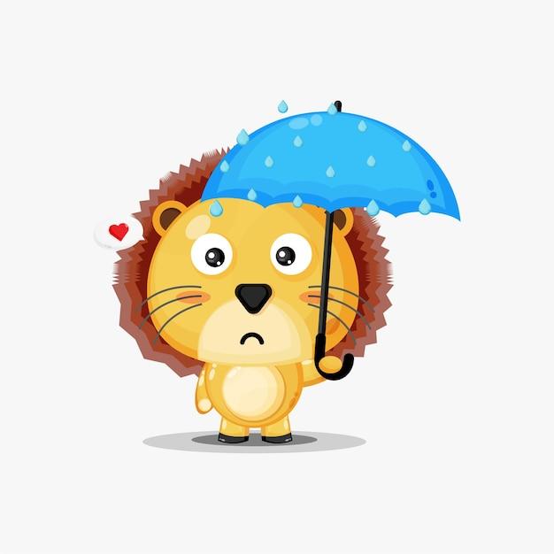 Leuke leeuw die een paraplu in de regen draagt
