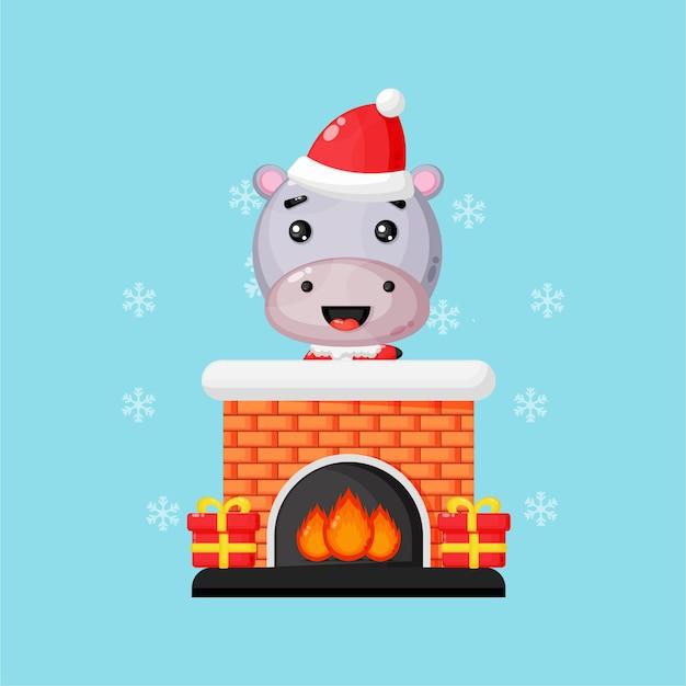 Leuke nijlpaard op de open haard van de schoorsteen van kerstmis