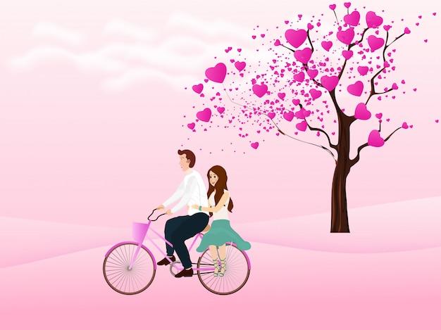 Leuke paar berijdende fiets en liefdeboom op de achtergrond.
