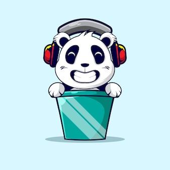 Leuke panda in de emmer en gebruik de hoofdtelefoon