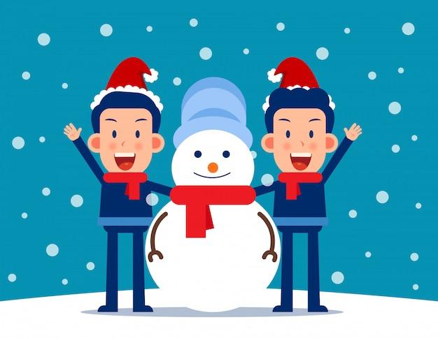 Leuke persoon en een sneeuwpop. winter seizoen concept