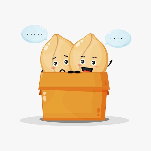 Leuke pinda-mascotte in de doos