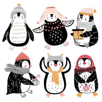 Leuke pinguïns die plezier hebben in het winterseizoen