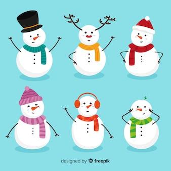 Leuke sneeuwpop kerst collectie in platte ontwerp