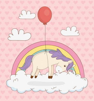 Leuke sprookjesachtige eenhoorn met ballonhelium en regenboog
