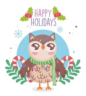 Leuke uil met sjaal en snoep stokken takken vrolijk kerstfeest