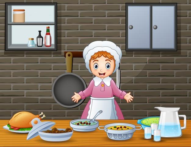 Leuke vrolijke vrouw die en voedsel in de keuken kookt voorbereidt