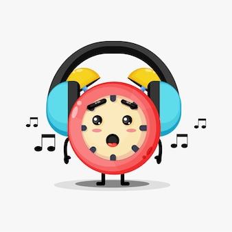 Leuke wekker mascotte luisteren naar muziek