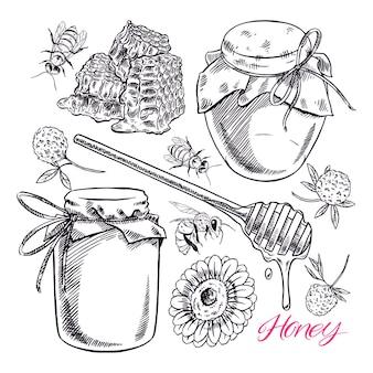 Leuke zwart-witte honingset. potten met honing, bijen en honingraat.