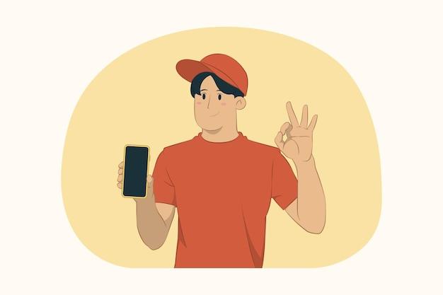 Levering jonge man houdt mobiel toon ok gebaar