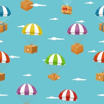 Levering naadloze achtergrond met geschenkdozen op parachutes.