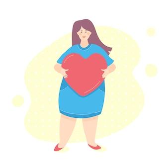 Lichaam positieve vrouw met hart in haar handen. hou van jezelf concept
