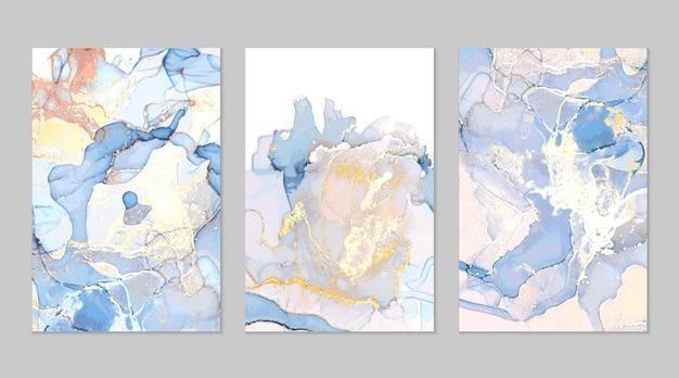 Lichtblauwe en gouden marmeren abstracte texturen