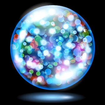 Lichtblauwe glazen bol gevuld met veelkleurige gloeiende glitters met bokeh-effect