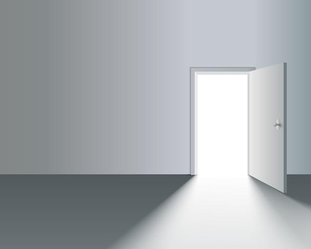 Lichte open deur in witte muur met schaduw