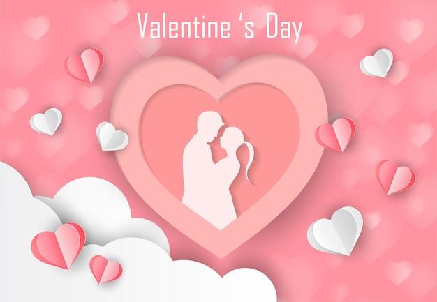 Liefde en valentijnsdag liefhebbers staan in de weilanden en een papieren kunsthart