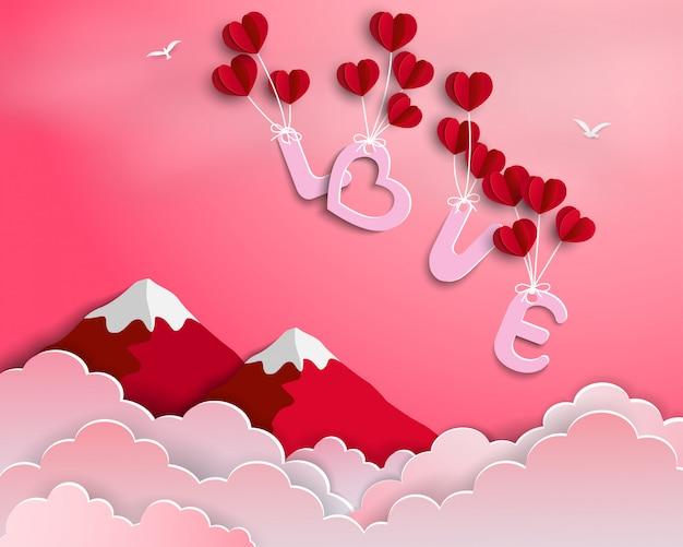 Liefde met rode ballonnen zwevend in de lucht