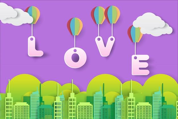 Liefdetekst vliegt over de stad met een heteluchtballon in papieren kunststijl