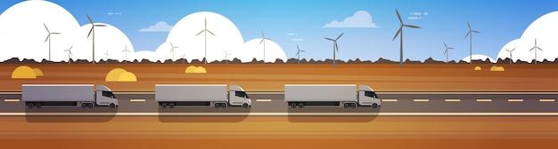 Lijn van cargo semi truck trailers rijden weg over natuur landschap horizontale banner