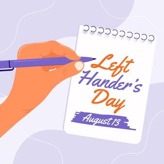 Linkshandige dag met hand en notebook