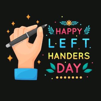 Linkshandige dag met handen die pen houden