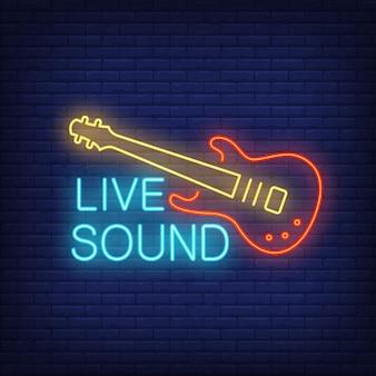 Live sound-neonreclame. elektrische gitaar op bakstenen muurachtergrond.