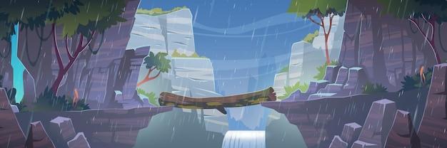 Logboekbrug tussen bergen boven klif bij regenachtig weer