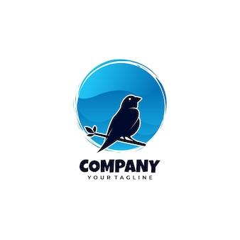 Logo blauwe vogel in de boom