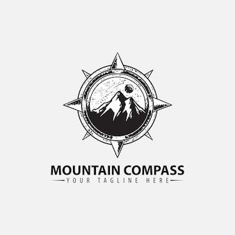 Logo met ontwerpsjabloon voor bergen en kompas