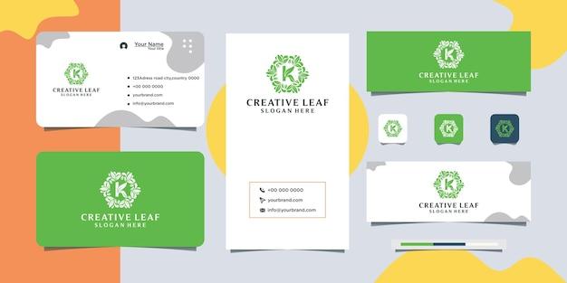 Logo-ontwerp in lineaire stijl met bloemen en bladeren en visitekaartjeontwerp
