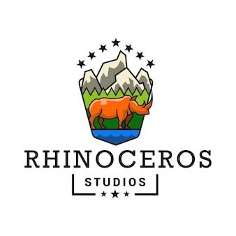 Logo rhinoceros mountain studio voor kunstfotografie en avontuurlijke natuur