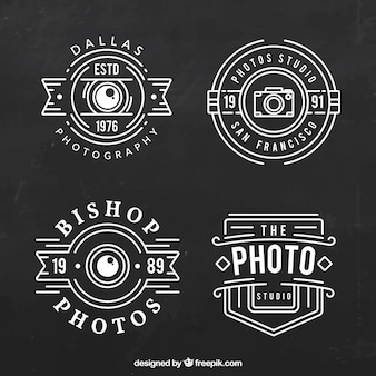 Logo's voor fotografie met witte lijnen op een zwarte achtergrond
