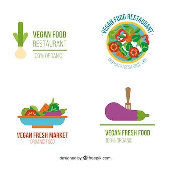 Logos van veganistisch eten in plat design