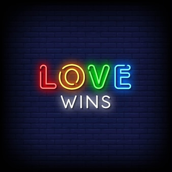 Love wins neon signs style text op blauwe muur