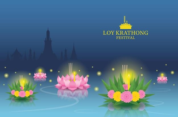 Loy krathong festival op de rivier, tempel landmark skyline achtergrond