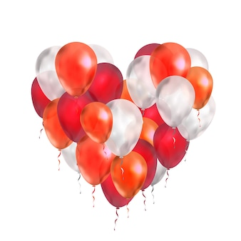 Luxe ballonnen in rode en witte kleuren in hartvorm op wit wordt geïsoleerd