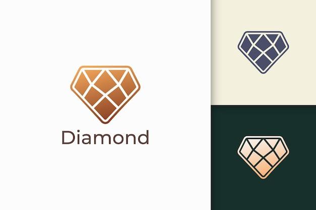 Luxe edelsteen- of juweellogo in ruitvorm met gouden kleur