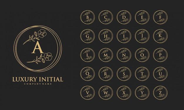 Luxe eerste logo ontwerp vector abstract
