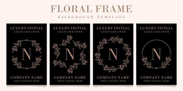 Luxe letter n logo ontwerp met bloemen frame achtergrond sjabloon
