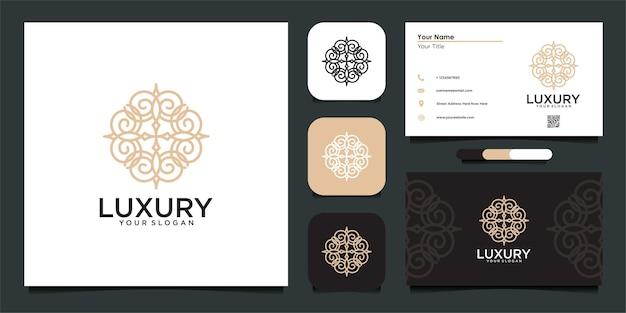 Luxe logo-ontwerp met stijlvol ornament en visitekaartje